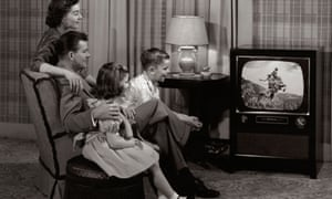 A family watching TV in the 1950s