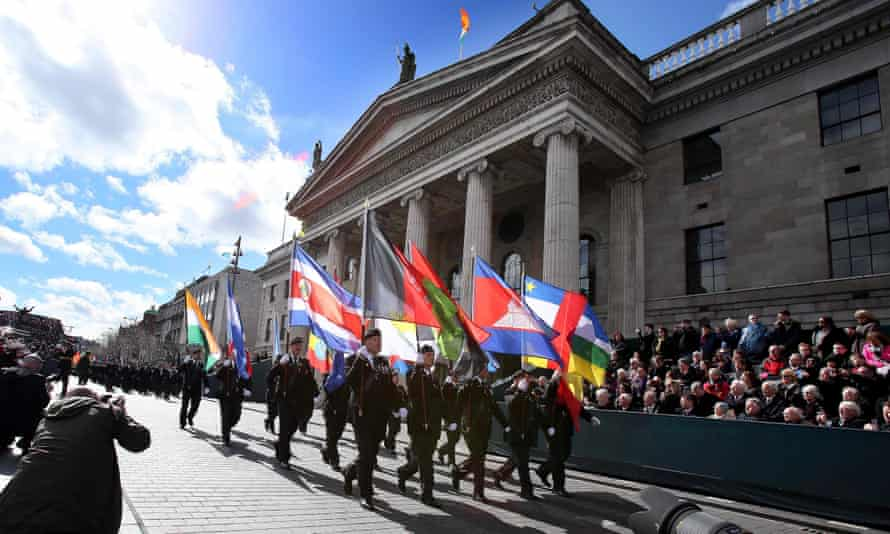 Members of the Irish army march past Dublin's General Post Office, scene of the 1916 Easter Rising.