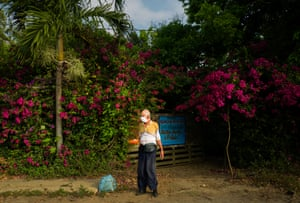 Cuban Anarle Travieso Figueroa leaves his house in the town of Bauta on the outskirts of Havana. Older adults are at increased risk of becoming infected with the Covid-19 virus, 12 April.
