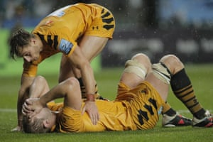 Wasps captain Joe Launchbury cuts a distraught figure on the ground after their loss.