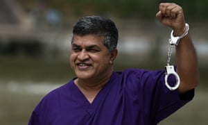 Malaysian cartoonist Zulkifli Anwar Ulhaque, popularly known as Zunar, poses with handcuffs prior to a book-launch event in Kuala Lumpur in February 2015.