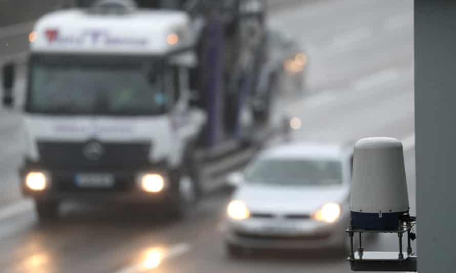 Vehicles pass a radar sensor mounted on a smart motorway, near Bagshot in Surrey.