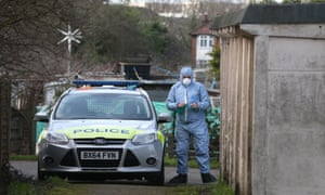A forensics officer at the scene where the body of Lea Adri-Soejoko, 80, was found in a lock-up store at an allotment in Colindale, north west London.