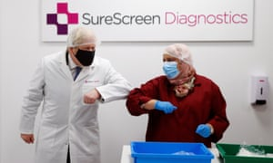 Boris Johnson meeting an employee during a visit to SureScreen Diagnostics in Derby.