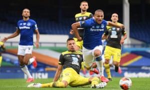 Richarlison of Everton is fouled by Jan Bednarek of Southampton.