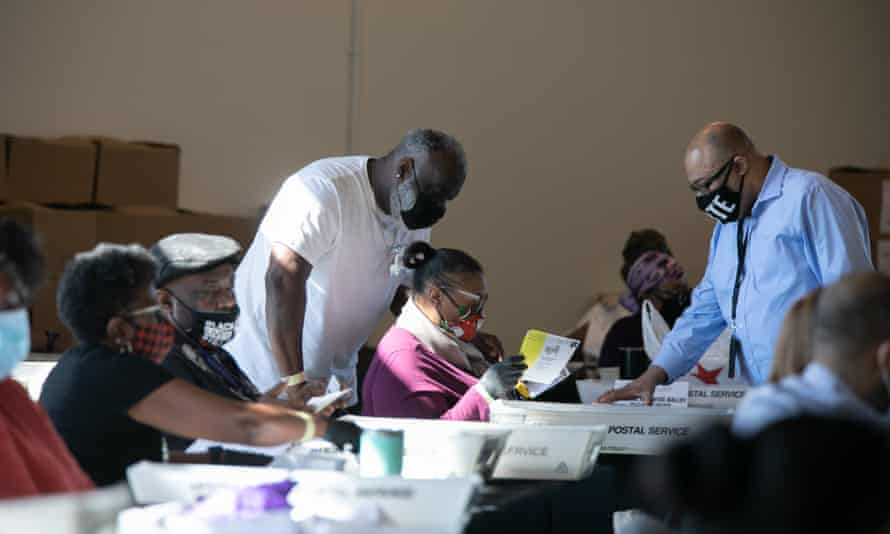 Election workers count Fulton county ballots in Atlanta, Georgia on Wednesday.