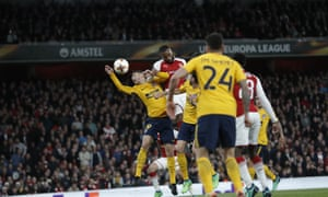 Lacazette gets up to head home the opener.