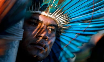 A South American Indian protests over land rights in Brazil.