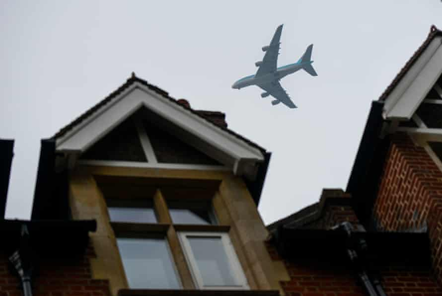 An aircraft flies over the roof of Zac Goldsmith's home in Richmond, London.