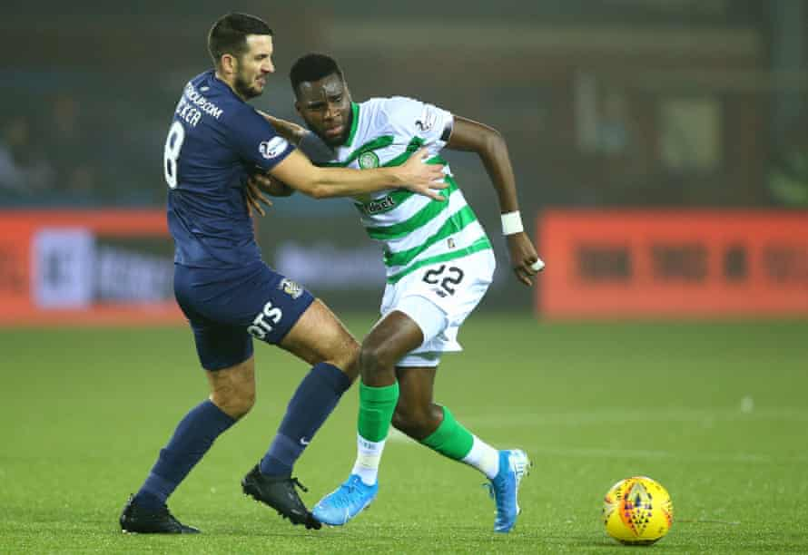 Gary Dicker grapples with Odsonne Édouard during Kilmarnock's game against Celtic in January 2020. He had six seasons at Kilmarnock and coached the reserves.