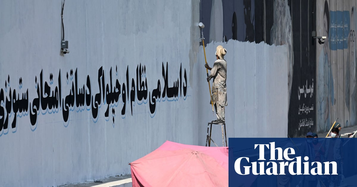 'The soul of Kabul': Taliban paint over murals with victory slogans