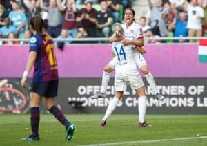 Olympique Lyonnais' Ada Hegerberg celebrates scoring their third goal with Amel Majri.