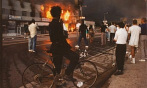 a view of businesses beginning to burn during the Rodney King riots 1992 in Los Angeles.