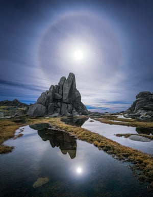 Cover imageA full moon alongside the planet Mars shining through cirrostratus clouds over Kosciuszko national park
