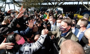 Jair Bolsonaro is greeted by supporters in Bage, Rio Grande do Sul state on Friday