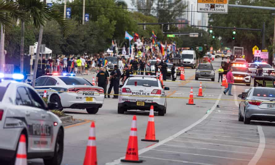 Police investigate the scene where a pickup truck drove into a crowd of people at a Pride parade in Wilton Manors, Florida, on Saturday.