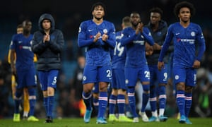 Reece James (centre) and Willian (right) look dejected as the Chelsea players applaud their fans.