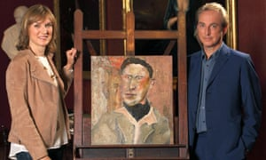 Fiona Bruce and Philip Mould with the portrait said to be by Lucian Freud.