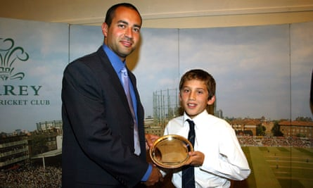 Ansari receives a Surrey youth cricket award from the former Surrey and England captain Adam Hollioake in 2003.