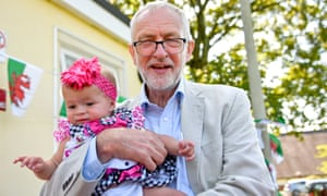 Jeremy Corbyn holding 9-month-old Narrah Godfrey-Collin during a visit to a kids' lunch club in Swansea, Wales, this afternoon.