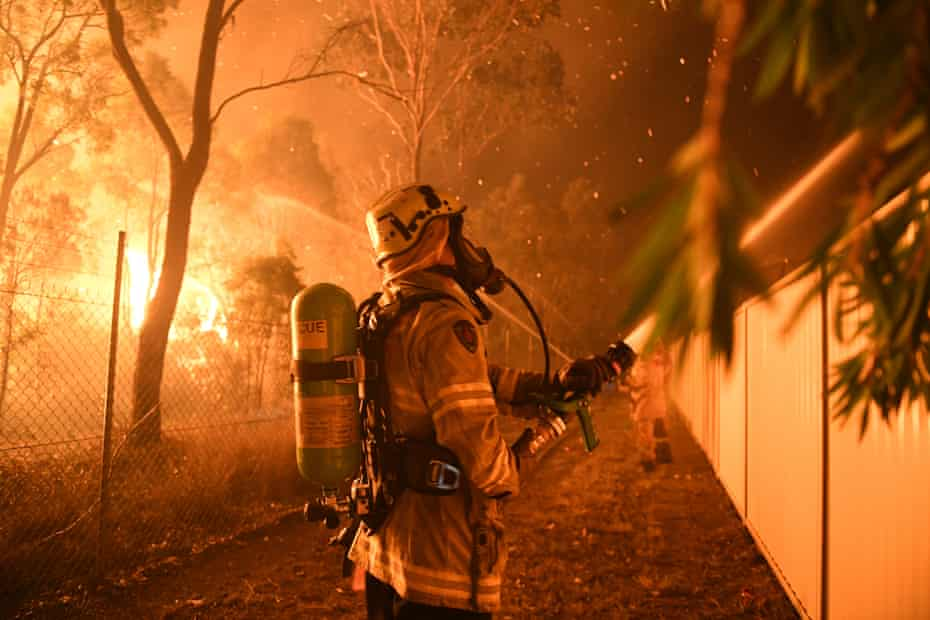 Firefighters fight flames close to homes in Wattle Grove in Sydney in mid-April.