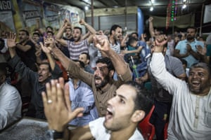 Egyptians celebrate Liverpool's goal while watching the UEFA Champions League Final football match between Tottenham Hotspur FC and Liverpool FC, at a cafe where Liverpool's Egyptian footballer Mohamed Salah was born and raised in the village of Nagrig.