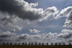 Cyclists ride in the countryside during the third stage between Binche and Epernay, Belgium.