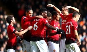Paul Pogba celebrates his second.