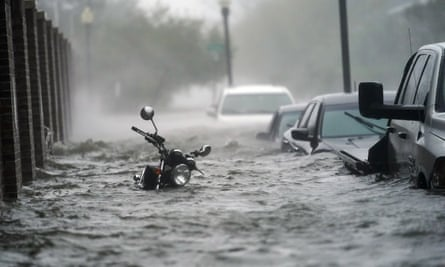 A picture of a motorcycle submerged in water as a result of Hurricane Sandy.