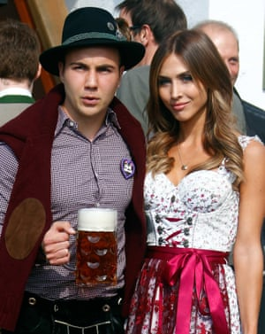 Mario Götze cuts a more serious figure as he poses with some beer and suede elbow patch alongside his girlfriend Ann-Kathrin Brommel