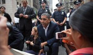 Activists, including New York's city council speaker Melissa Mark-Viverito and the US representative Adriano Espaillat, sit on Fifth Avenue.
