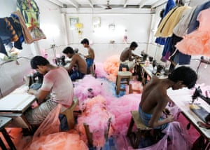 Employees work inside a garment factory in Mumbai, India. Some major brands have worked on reducing their environmental and social impact in manufacturing. But critics say there's a lot more that needs to be done.