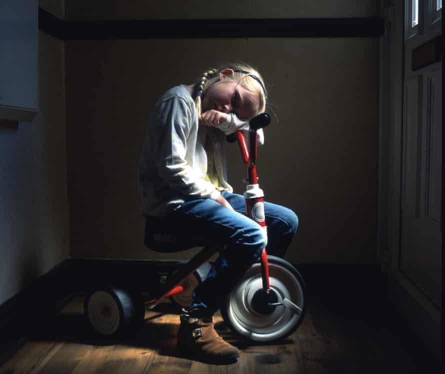 Sad child on bike