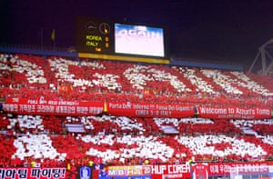 South Korean supporters hold up signs urging 'Again 1966' in reference to North Korea's victory over Italy.