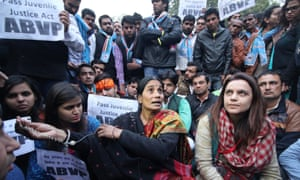 The mother (centre) of the woman raped and murdered in 2012 takes part in a rally in Delhi on 21 December to protest against the release of the youngest of six men found guilty of the crime.