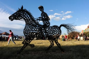 Underberg, South AfricaA festival goer walks past a metal artwork during the annual Splashy Fen music festival. The five day long event is 30 years old.