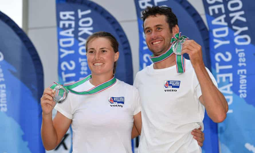 Anna Burnet & John Gimson proudly show their silver medals after the Ready Steady Tokyo Olympic test event at the Enoshima Yacht Harbour in Kanagawa, Japan.