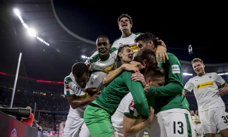 Borussia Mönchengladbach celebrate after Patrick Hermann's goal at the Allianz Arena.