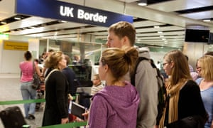 Young people waiting to enter the UK Border at immigration
