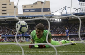 Chelsea goalkeeper Kepa Arrizabalaga reacts after failing to stop the goal scored by Arsenal's Alex Iwobi.