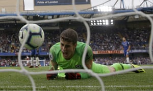 Chelsea goalkeeper Kepa Arrizabalaga reacts after failing to stop the goal scored by Arsenal's Alex Iwobi