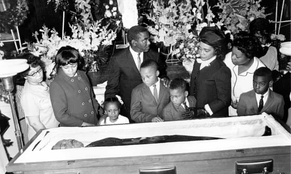 Coretta Scott King (fourth right) with her children – (from second left) Yolanda, 12, Bernice, five, Martin, 11, and Dexter, seven – at the casket of Martin Luther King Jr