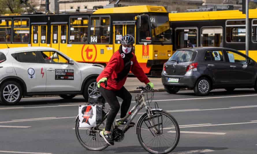 A woman rides her bicycle during a protest of Polish women's rights activists in Warsaw.