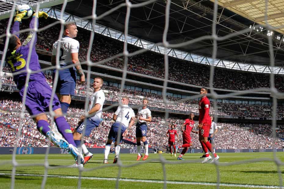 Spurs' keeper Michel Vorm claws away Georginio Wijnaldum's header from behind the goal-line.