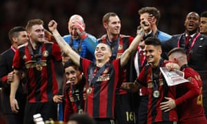 Miguel Almiron celebrates with his Atlanta teammates after clinching the MLS Cup last season