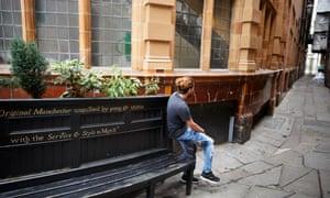 former asylum seeker on a bench in Manchester