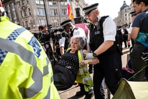 An activist is arrested by police at Oxford Circus