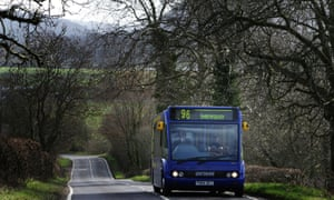 A bus travels a rural road in the UK