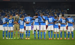 Napoli players observe a minute of silence prior to kick off in memory of Diego Maradona.