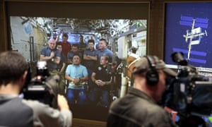 A screen of the Russian Mission Control Center shows live television of the International Space Station crew members as they take part in the news conference on Tuesday.